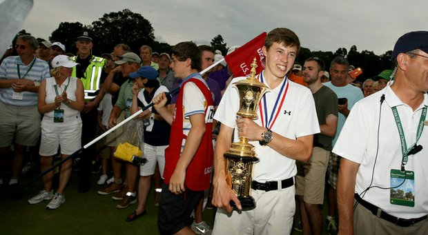 Matthew Fitzpatrick proudly holds the Havemeyer Trophy after defeating Oliver Goss, 4 and 3, at the 2013 U. S. Amateur at The Country Club.