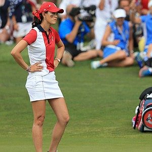 Michelle Wie of the United States team looks on as Caroline Hedwall of Sweden and the European team win the 16th hole to bring their match to all square during the final day singles matches of the 2013 Solheim Cup.