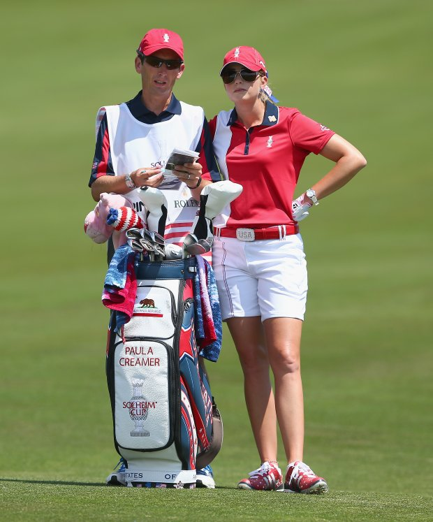 Paula Creamer of the U.S. Solhiem Cup team and her caddie Colin Cann talk in the fairway on the 1st hole during the final day singles matches of the 2013 Solhiem Cup.