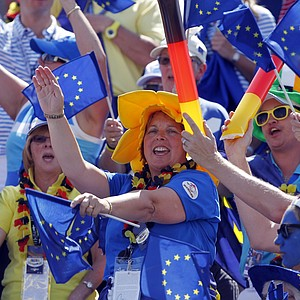 Fans cheer for Europe at the first tee prior to the state of singles matches at the Solheim Cup.