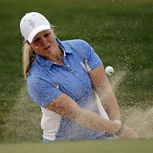 Europe's Caroline Hedwall, from Sweden, hits from a sand trap on the eighth hole during her singles match against United States' Michelle Wie at the Solheim Cup.