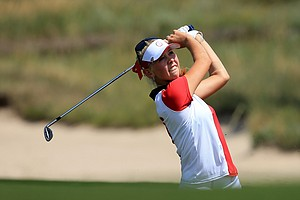 Jessica Korda of the U.S. plays her third shot at the first hole during the final day singles matches in the 2013 Solheim Cup.