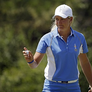 Europe's Suzann Pettersen, from Norway, waves to the crowd after parring the second hole during her singles match against United States' Lizette Salas at the Solheim Cup.