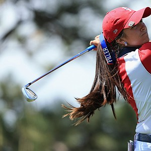 Gerina Piller of the United States team hits her tee shot on the second hole during the final day singles matches of the 2013 Solheim Cup.