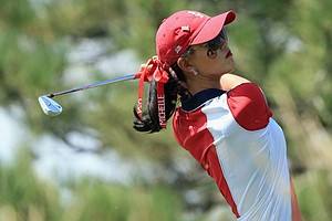 Michelle Wie of the United States team hits her tee shot on the second hole during the final day singles matches of the 2013 Solheim Cup.