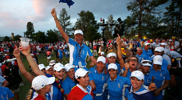Members of the European team hold Captain Liselotte Neumann on their shoulders as they celebrate defeating the United States 18-10 in the 2013 Solheim Cup.