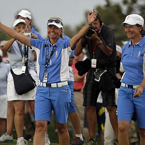 European captain Liselotte Neumann (left) with Catriona Matthew after clinching the 2013 Solheim Cup at Colorado Golf Club.