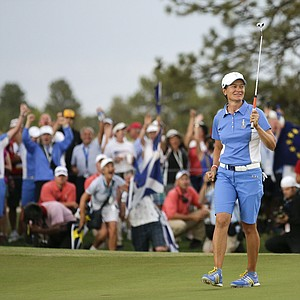 Catriona Matthew after making the putt that clinched victory for Europe in the 2013 Solheim Cup at Colorado Golf Club.
