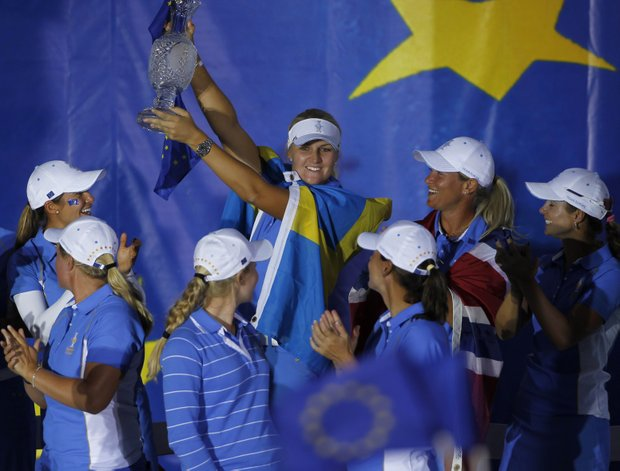 Europe's Anna Nordqvist holds up the Solheim Cup trophy during 2013's closing ceremonies at Colorado Golf Club.