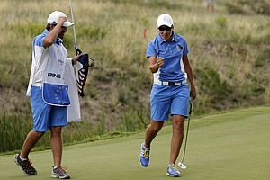Carlota Ciganda celebrates a win during singles play in the 2013 Solheim Cup at Colorado Golf Club.