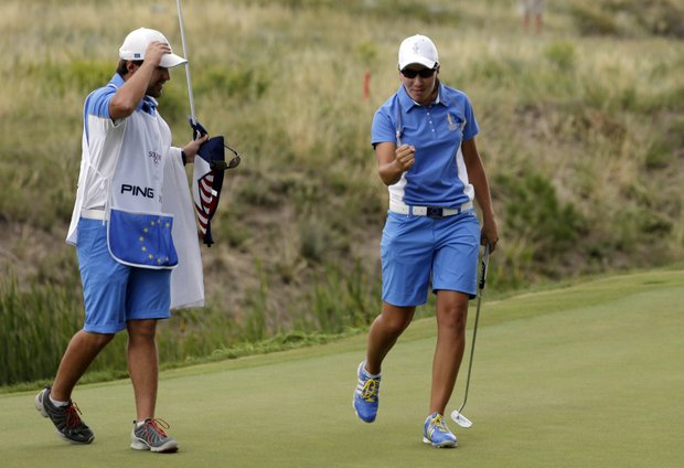 Carlota Ciganda celebrates a win during singles play in the 2013 Solheim Cup at Colorado Golf Club.