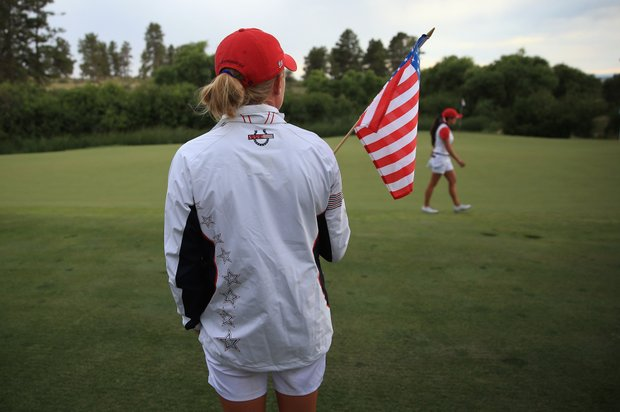Morgan Pressel watches Gerina Piller at Colorado Golf Club's 17th hole during Sunday singles at the 2013 Solheim Cup.