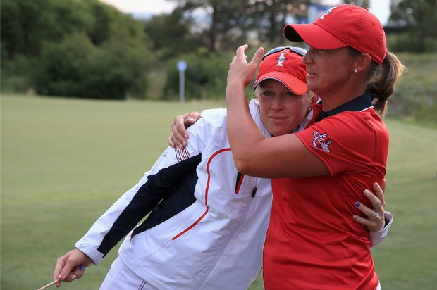 Morgan Pressel (left) and Angela Stanford after both lost during Sunday singles at the 2013 Solheim Cup at Colorado Golf Club.