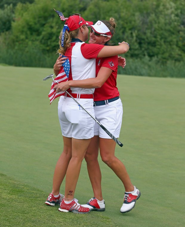 Paula Creamer (left) and Brittany Lang after Lang's win during Sunday singles matches in the 2013 Solheim Cup at Colorado Golf Club.