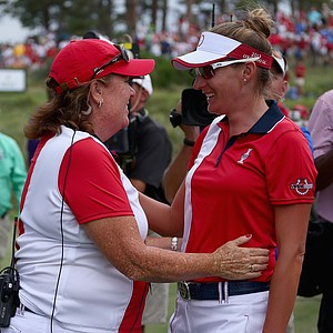 Meg Mallon congratulates Brittany Lang after her Sunday singles win in the 2013 Solheim Cup at Colorado Golf Club.