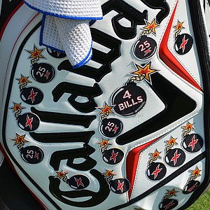 "Gary Woodland's Callaway golf bag is covered with ""X Bomb"" patches that represent 325-yard drives. The ""4 Bills"" bomb represents a drive that went at least 400 yards."