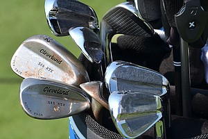 Boo Weekley's Cleveland Forged 588 MB irons are covered in weight tape.