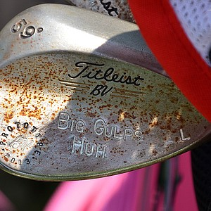 Rickie Fowler's rusty Titleist Vokey Design lob wedge has plenty of custom stamping.