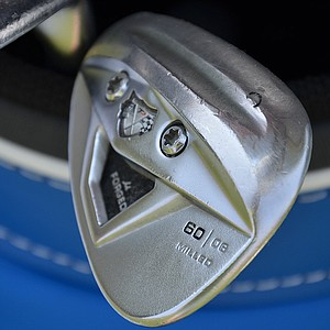 Brian Harman's TaylorMade TP w/xFT lob wedge has a unique groove ground into its sole to make it easier to get under the ball from tight ties.