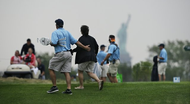Fans leave the course during a weather delay at the 2013 Barclays at Liberty National.