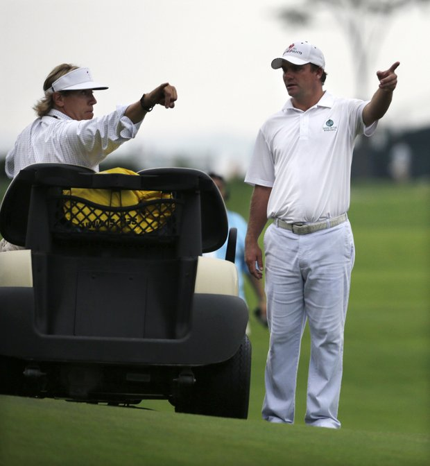 Michael Thompson consults a rules official before a weather delay at the 2013 Barclays at Liberty National.