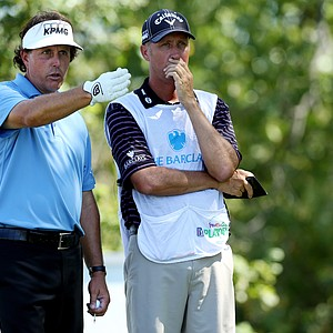 Phil Mickelson and caddie Bones MacKay during the final round of The Barclays, the first event of the 2013 FedEx Cup playoffs, at Liberty National.