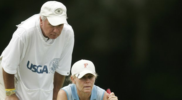 Mary Jane Hiestand with her caddie/husband Jeff.