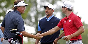 How it happened: Tiger shoots 67; Garcia leads by 1