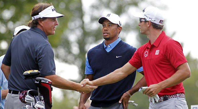 Phil Mickelson, Tiger Woods and Adam Scott before beginning their first rounds at the Deutsche Bank Championship Friday at TPC Boston.