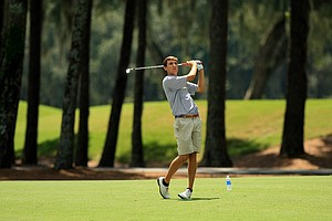 Scottie Scheffler hits a shot at No. 15 during the final round of the Junior Players Championship at TPC Sawgrass.