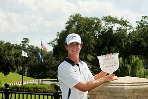 Austen Truslow holds the trophy from the Junior Players Championship at TPC Sawgrass.