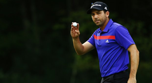Sergio Garcia holds up his ball after putting for birdie on the 12th green during the third round of the Deutsche Bank Championship at TPC Boston.