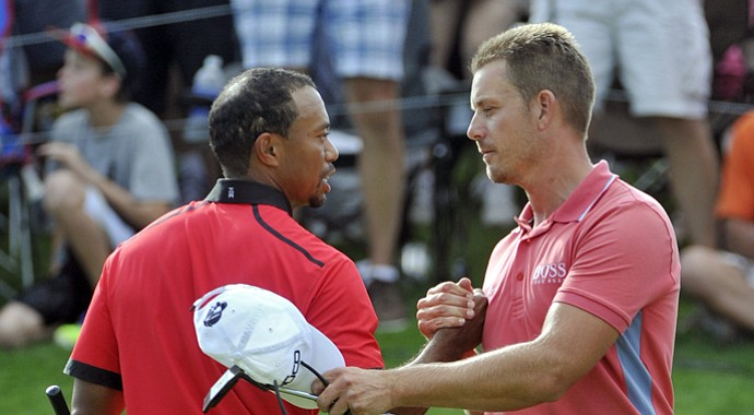 Tiger Woods (left) is congratulated by Henrik Stenson after winning the 2013 Bridgestone Invitational.
