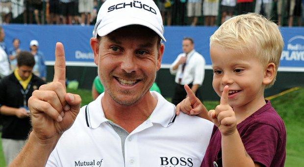 Henrik Stenson celebrates with his son Karl after winning the Deutsche Bank Championship at TPC Boston.