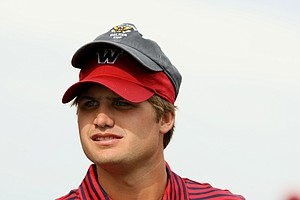 USA's Bobby Wyatt wearing a couple of Walker Cup hats during the 2013 Walker Cup at National Golf Links of America in Southampton, N.Y.