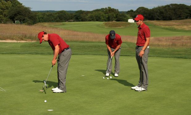 USA's Michael Weaver, Todd White and Patrick Rodgers on the practice green during the 2013 Walker Cup at National Golf Links of America in Southampton, N.Y.
