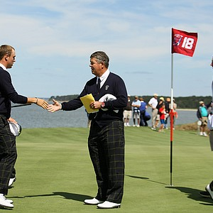 USA captain Jim Holtgrieve with his team at No. 18 during Friday's practice at the 2013 Walker Cup at National Golf Links of America in Southampton, N.Y.