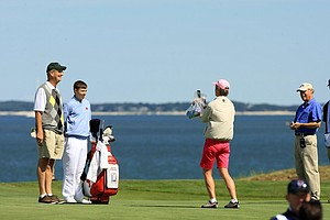 GB&I's Matt Fitzpatrick, the current U. S. Amateur champion poses for pictures with spectators during Friday's practice at the 2013 Walker Cup at National Golf Links of America in Southampton, N.Y.