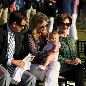 Jenna Bush Hager, center, with her husband Henry Hager, left, and her mom, Laura, and daugher, Mila, during the opening ceremony at the 2013 Walker Cup at National Golf Links of America in Southampton, N.Y.