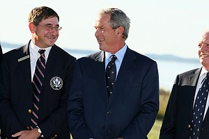 Former president George W. Bush speaks with USGA president Glen D. Nager during opening ceremonies at the 2013 Walker Cup at National Golf Links of America in Southampton, N.Y.