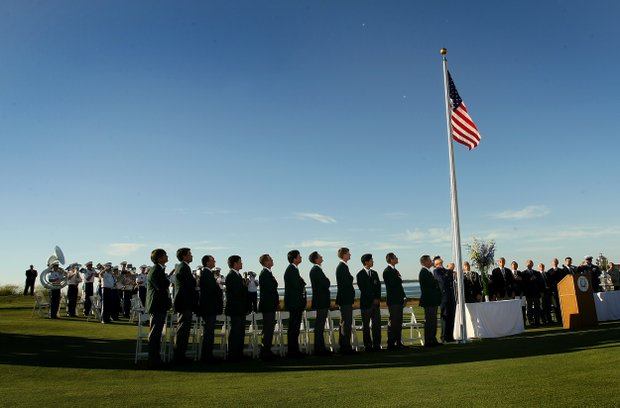 Team USA stands as the American Flag is flown during the opening ceremony at the 2013 Walker Cup at National Golf Links of America in Southampton, N.Y.