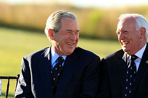 Former President George W. Bush chats with Wilson Sibbett, chairman of the general committee of The R & A, during the 2013 Walker Cup at National Golf Links of America in Southampton, N.Y.
