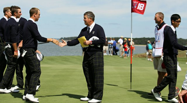 U.S. Walker Cup captain Jim Holtgrieve greets his players at National Golf Links on the eve of the 2013 Walker Cup.