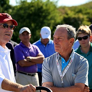 New York City mayor Michael Bloomberg chats with former president George W. Bush on Saturday of the 2013 Walker Cup at National Golf Links of America in Southampton, N.Y.
