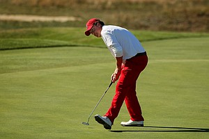 USA's Nathan Smith watches his putt at No. 10 on Saturday of the 2013 Walker Cup at National Golf Links of America in Southampton, N.Y.