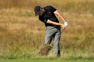 GB&I's Rhys Pugh hits a shot out of the rough at No. 11 on Saturday of the 2013 Walker Cup at National Golf Links of America in Southampton, N.Y.