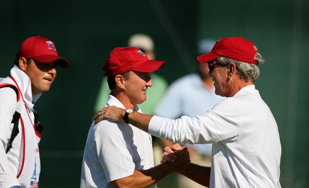 Former president George W. Bush congratulates USA's Todd White at No. 11 after he made birdie on Saturday of the 2013 Walker Cup at National Golf Links of America in Southampton, N.Y.