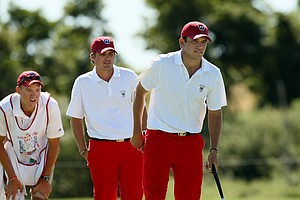 USA's Cory Whitsett, right, and Bobby Wyatt with Whitsett's caddie Sean Piotrowski on Saturday of the 2013 Walker Cup at National Golf Links of America in Southampton, N.Y.