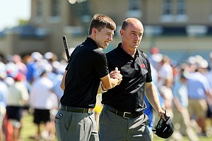 GB&I captain Nigel Edwards congratulates Matthew Fitpatrick on his win with Neil Raymond over USA on Saturday of the 2013 Walker Cup at National Golf Links of America in Southampton, N.Y.