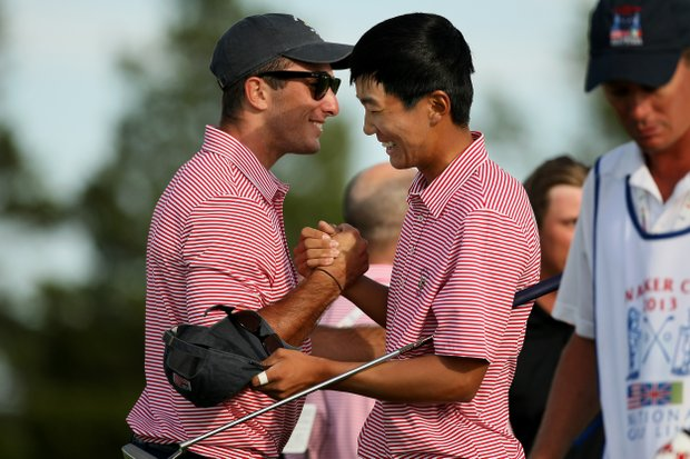 Max Homa and Michael Kim celebrate after they both won  their singals matches on Saturday of the 2013 Walker Cup at National Golf Links of America in Southampton, N.Y.
